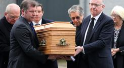 Foreign Affairs Minister Charlie Flanagan carries his mother's coffin before the funeral Mass for Mai Flanagan at St Joseph's Church in Mountmellick, Co Laois. Picture: Frank McGrath