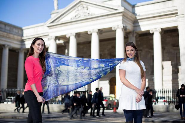 Artist Emily MacDonald with Dairine Kennedy from KDK with one of their scarfs featuring the College Green print. Photo: Mark Condren