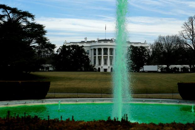 The water in the fountain on the South Lawn of the White House flows green in celebration of St Patrick's Day yesterday. Photo: Reuters