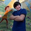 12 year old Eliot Brennan, (6th class) who designed Cú Chulainn (in background), one of the pupils of St.Columba's National School, North Strand at the unveiling of the mosaic which the pupils created. Picture: Tom Burke