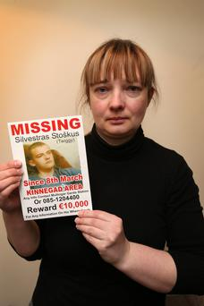 Vilma Stoskus, mother of Silvestras, with his missing poster at her Kinnegad, Co. Kildare home last night.