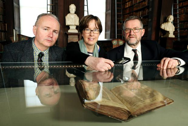 Trinity's Professor in Medieval History Sean Duffy, Principal Curator of Manuscripts & Research Library Jane Maxwell and Head of Research Collections and the Keeper of Manuscripts, Bernard Meehan. Photo: Maxwells