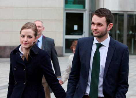 Daniel and Amy McArthur of Ashers Bakery leaving Belfast County Court yesterday. Photo: PA