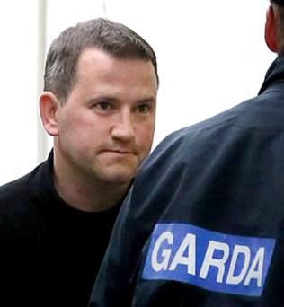 Graham Dwyer is led away after his conviction for murder. Photo: Gerry Mooney
