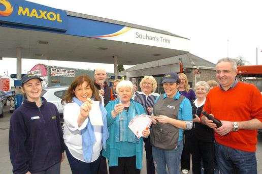 Staff at Souhan's in Trim, Co Meath, celebrate selling the winning €10m quick pick Lotto ticket