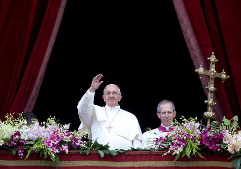 The Pope delivershis Easter message from the balcony overlooking St. Peter's Square at the Vatican yesterday. Photo: Reuters