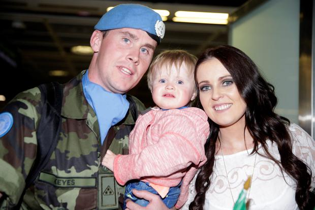 Declan Keyes, from Athlone, welcomed home by wife Michelle Ganley and son Cody (21 months) at Dublin Airport last night.