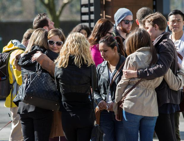 Classmates of Karen Buckley gather together on the campus of Glasgow Caledonian University yesterday. Photo: Mark Condren