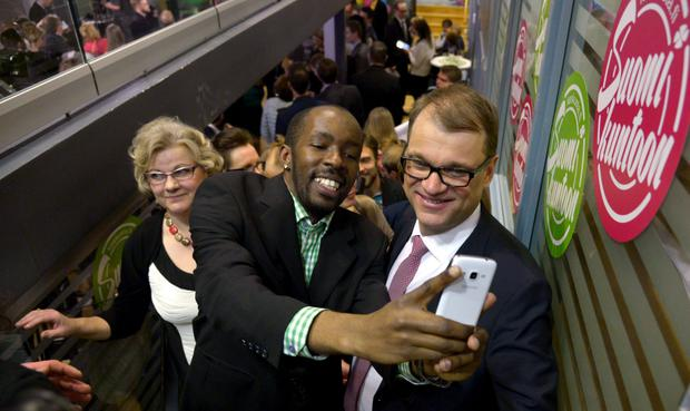 AFTER THE ELECTION: A supporter takes a selfie of himself and Centre Party chairman Juha Sipila in Helsinki last week