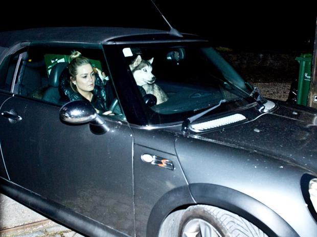 Blaise O'Donnell, the daughter of Brian and Mary Patricia, leaves Gorse Hill last night with boxes and two dogs in the car