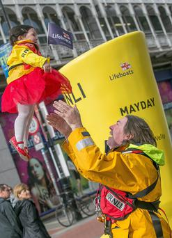 Ian Sheridan, Howth RNLI and his 22 month old daughter Astrid at the launch of the RNLI's Mayday fundraising campaign on Grafton Street. Photo: Pat Moore.