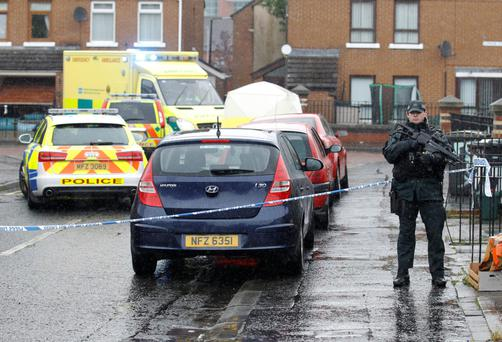 Police in Welsh Street, in the Markets area near Belfast city centre following the fatal shooting of Gerard