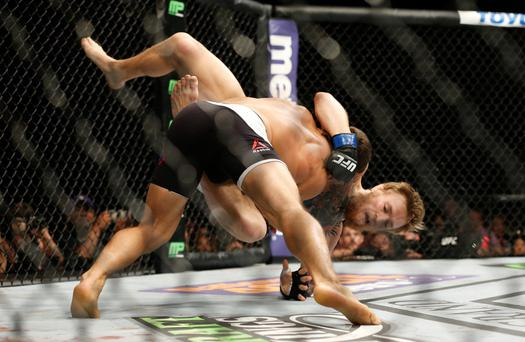 Conor McGregor gets taken down by Chad Mendes. Photo: AP