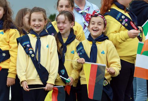 Aishling Mooney [7] Amelia Byrne[7] and Olivia Onofri [7] from Dunshaughlin Girl Guides and Brownies form part of the Aras an Uachtarain guard of Honour