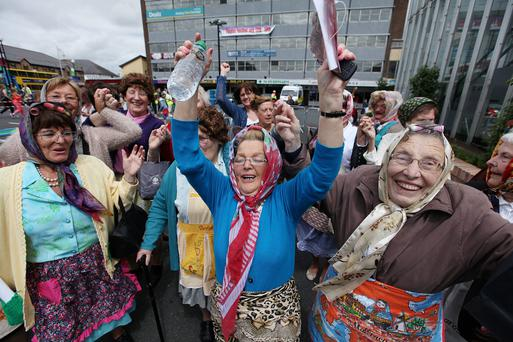 Some of the nearly 100 people who dressed up for the Mrs Brown's Boys-themed world record attempt at the Finglas Festival in Dublin yesterday. Photo: Stephen Collins