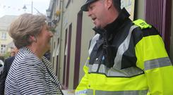 Justice Minister Frances Fitzgerald meets local garda Emmett Cassidy while attending the MacGill Summer School in Glenties yesterday