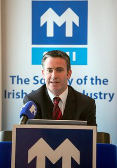 Minister of State Damien English speaking at the announcement of the SIMI Motor Industry second quarter review for 2015