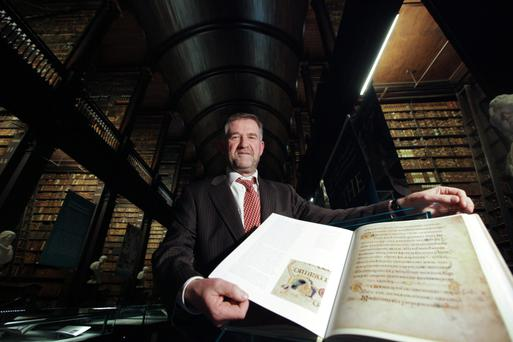 National treasure: Dr Bernard Meehan, the Keeper of Manuscripts at Trinity College Library with a copy of the Book of Kells