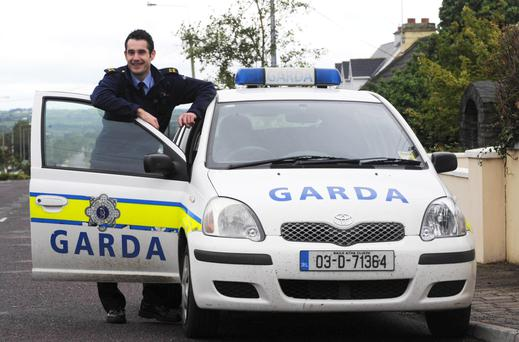 Kerry full back Garda Tom O'Sullivan pictured on duty in Moyvane, County Kerry