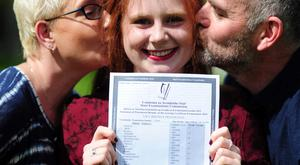 Lucy Prendeville (18), a Sacred Heart School student, Tullamore, Co Offaly, who got eight A1s in the Leaving Cert is congratulated by her parents Catherine and Richard