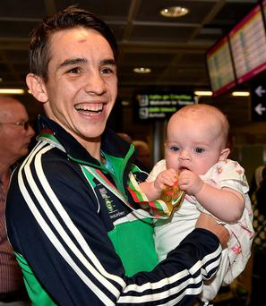 Gold medal bantamweight winner Michael Conlan with his daughter Luisne (five months)