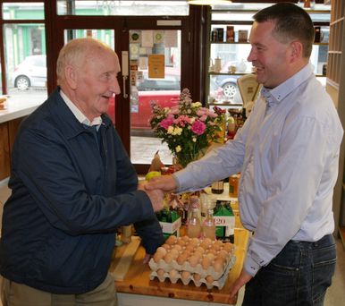 Councillor Paschal Fitzmaurice chatting with Michael Shiel in Benny's Deli on Main Street, Castlerea, Co Roscommon yesterday Photo: David Walsh