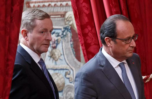Taoiseach Enda Kenny, left, and French President Francois Holland