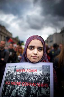 Taking a stand: Maryam Filaih, from Dublin, at a welcome rally on O'Connell Street yesterday