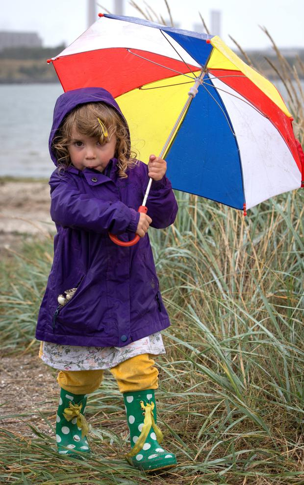 Natalia Condron (3) out walking in the heavy rain in Sandymount, Dublin, yesterday Photo: Fergal Phillips