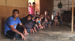 Left: Syrian refugee Abdullah Al Hamad and his family, who have been living in a refugee camp for two years