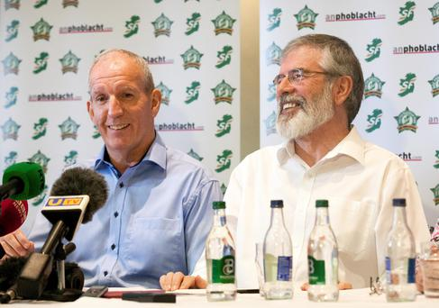 Sinn Fein's northern chairman Bobby Storey (left) and Sinn Fein president Gerry Adams at a press conference yesterday