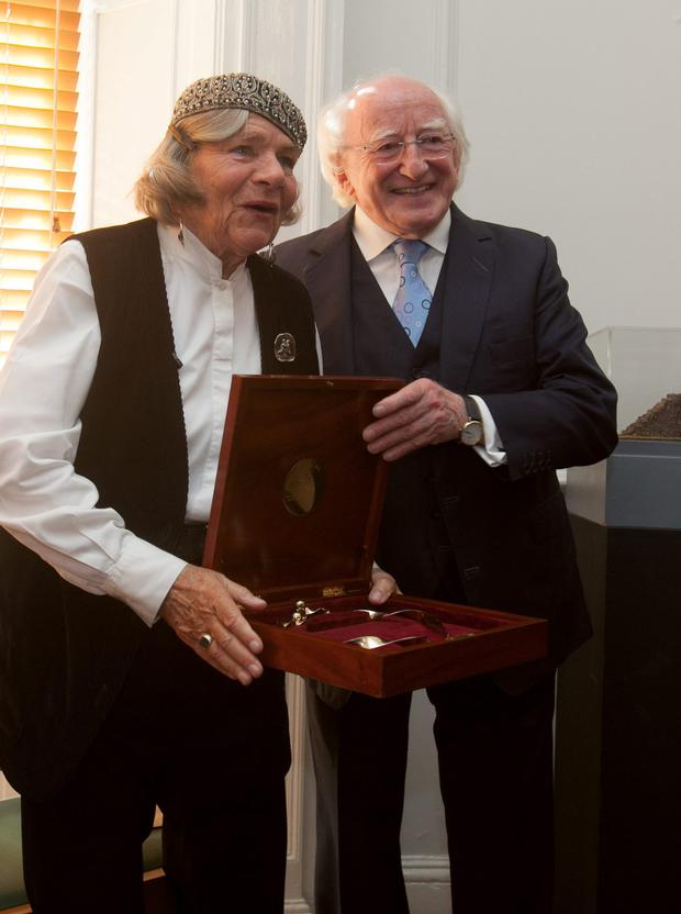 President Michael D Higgins with Imogen Stuart during an Aosdá ceremony in Dublin yesterday at which she was conferred with the title of Saoi of Aosdána. Photo: Gareth Chaney