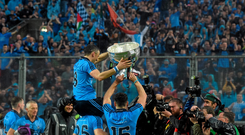 Dublin players, Kevin McManamon, Alan Brogan, and Bernard Brogan celebrate with the Sam Maguire cup after the game