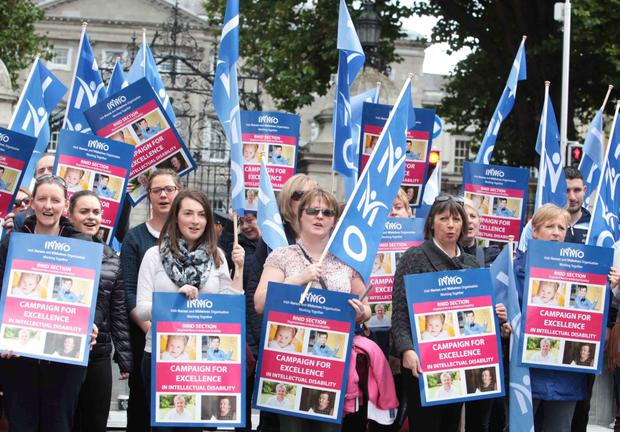 Members of the Irish Nurses and Midwives Organisation protest at LeinsterHouse as part of their 'Campaign for Excellence' in Intellectual Disability Services. Photo: Leah Farrell