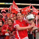 Cork fans celebrate as Áine O'Sullivan, Cork, holds the Brendan Martin cup aloft. Photo: Dáire Brennan