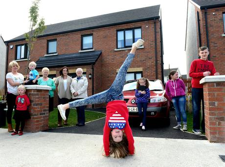 Lucy Clinton (11) is head over heels with her new house in Moneymore as the newest social housing scheme is oficially opened in Drogheda. Also pictured are (left to right) Donna Cunningham (Lucy's mum). Cavern and Abbey and Martha Clinton, Rosslyn and Mari