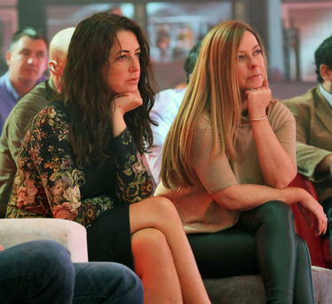 Mary Moloney, CEO of Koderdojo, left, and Naomi Moore, CEO of Windmill Lane Recording Studio, listen to Richard Branson speaking at the RDS Photo: Colin Keegan