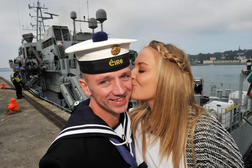 Leading Seaman Alex Casey gets a kiss from partner Aoife Hernon