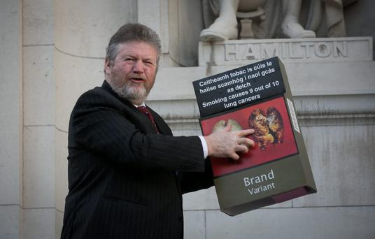 Children's Minister Dr James Reilly has been praised by health groups for taking a tough line against smoking