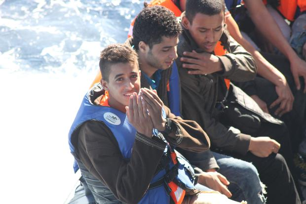 A refugee gestures his thanks as he is rescued by the crew of the LÉ Niamh