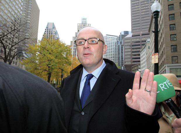 David Drumm, the former chief executive of Anglo Irish Bank, arrives at a courthouse in Boston to attend to a creditors' meeting in 2010