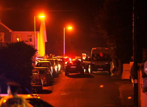 Gardai close off the road in Omeath, Co Louth after the shooting