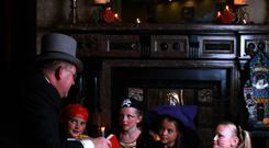 Hayfield Manor's famous doorman, Frank O'Mahony, reading scary fireside stories to Halloween children