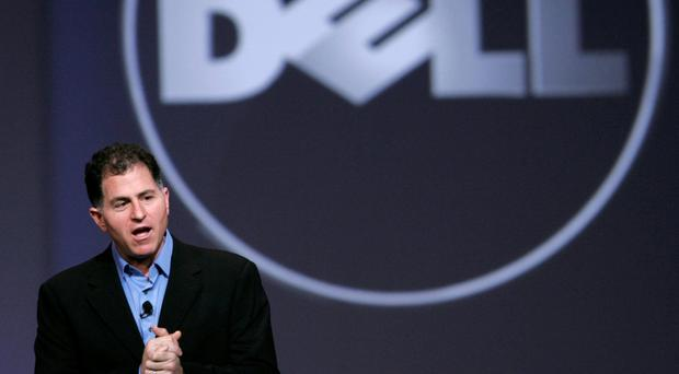 Dell Inc. CEO Michael Dell gives keynote address at Oracle Open World in San Francisco...Dell Inc. Chief Executive Officer Michael Dell speaks during his keynote address at Oracle Open World in San Francisco, California in this file photo taken October 13, 2009. Dell Inc on Tuesday reported an 11 percent drop in revenue, hurt by a shrinking consumer business, as investors weighed founder Michael Dell's offer to buy out the world's No.3 personal computer maker. REUTERS/Robert Galbraith/Files (UNITED STATES - Tags: BUSINESS)...A