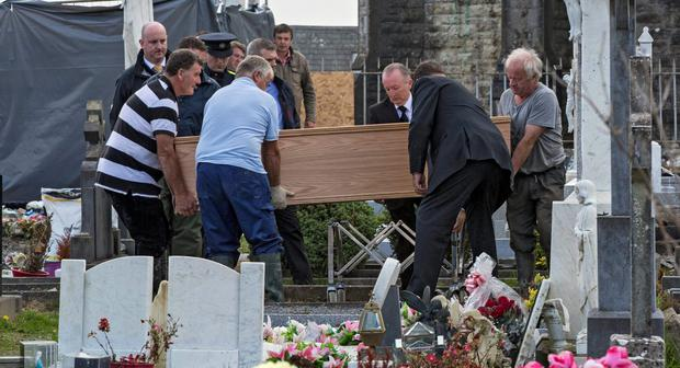 The remains of Margot Seery are disinterred from Rathkeale parish graveyard in Rathkeale, Co Limerick last September. Photo: courtesy RTÉ 'Prime Time'