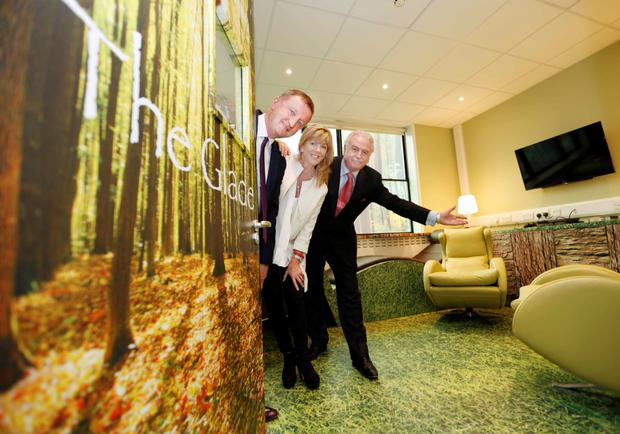 RTÉ broadcaster Marty Whelan with Sandra and Don Nugent in The Glade, a new chill-out room for patients on the oncology wards of Beaumont Hospital and their families