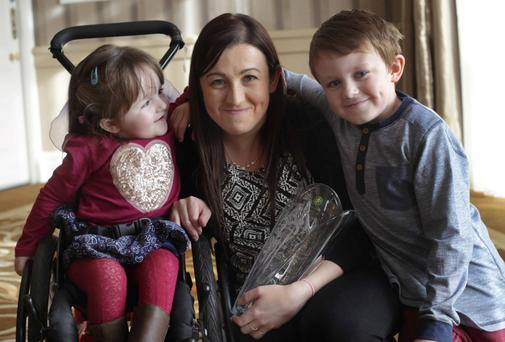 Jennifer Carroll from Ballyclare, Co Offaly, with her children Ava (3) and Alex (8)