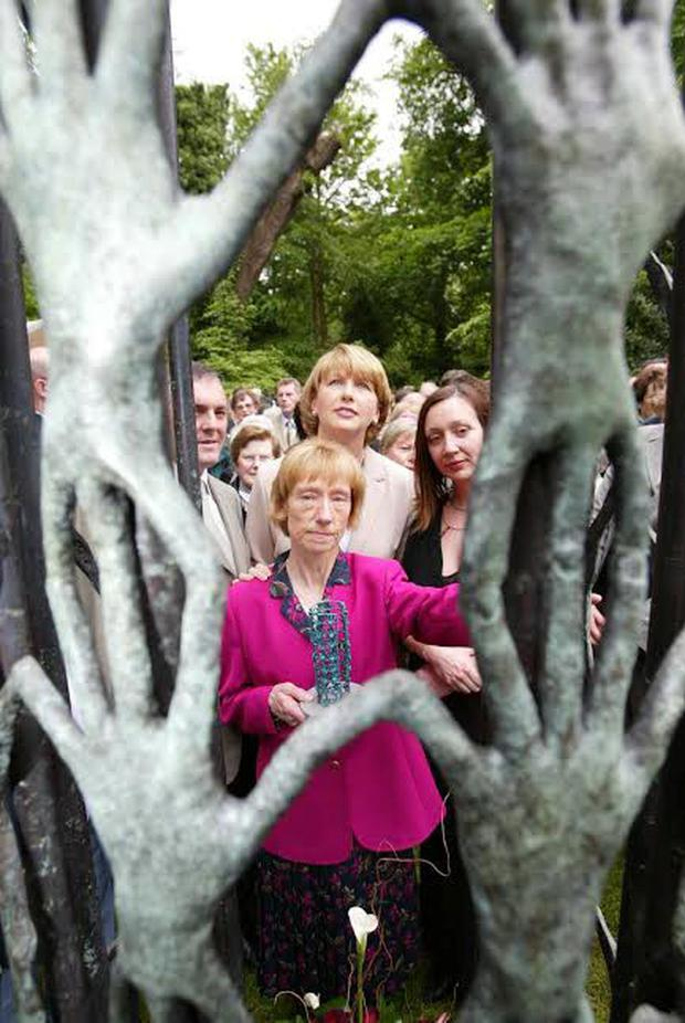 Reaching out: Sculptor Ann Mulrooney (right) with John McGuinness TD, Jo Jo Dollard's sister, Mary Phelan and Mary McAleese at the unveiling in 2002 of a monument for missing persons in the grounds of Kilkenny Castle. Photo: Dylan Vaughan