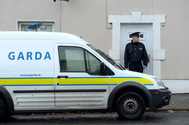 A garda at the house in Ballynacargy, Co Westmeath, where her body was found