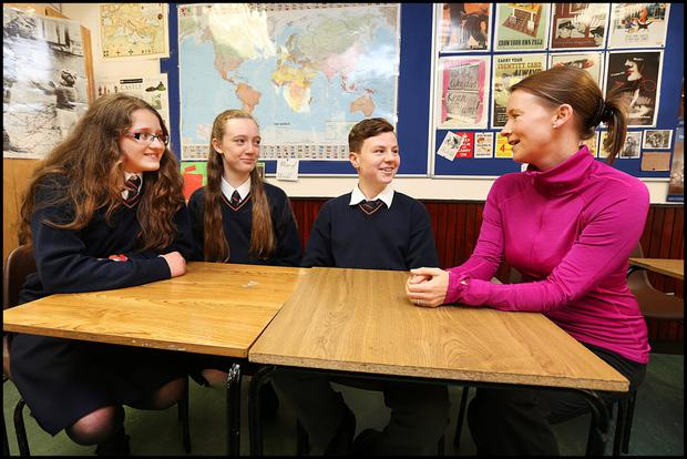 Stratford College students Melanija Cvetic, Emma Smyth and Jakob Miller with PE, SPHE teacher and TY Coordinator Linda Finegan taking part in the Friends for Life Wellbeing Programme for Secnd Year students Photo: Steve Humphreys